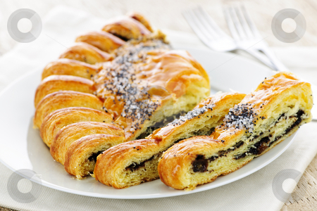Poppy seed strudel stock photo, Closeup of poppy seed strudel dessert pastry with slices by Elena Elisseeva
