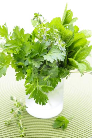 Fresh herbs in a glass stock photo, Assortment of fresh organic green herbs in glass by Elena Elisseeva