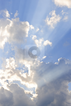 Blue sky with sun rays stock photo, Background of blue sky with sun rays and clouds by Elena Elisseeva