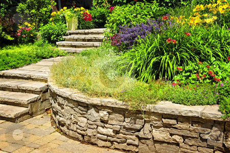 Natural stone landscaping stock photo, Natural stone landscaping in home garden with stairs and retaining walls by Elena Elisseeva