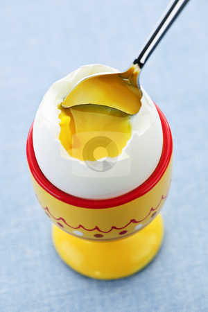 Soft boiled egg in cup stock photo, Closeup of soft boiled egg in cup with spoon by Elena Elisseeva