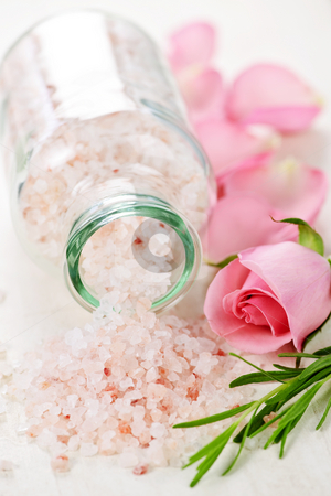 Bath salts stock photo, Pink bath salts in a glass jar with flowers and herbs by Elena Elisseeva