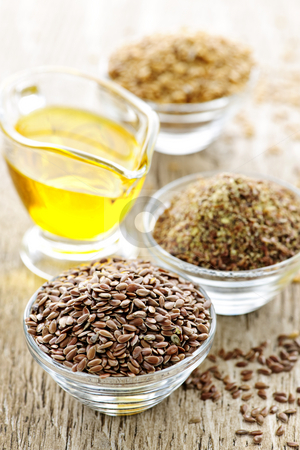 Flax seeds and linseed oil stock photo, Bowls of whole and ground flax seed with linseed oil by Elena Elisseeva