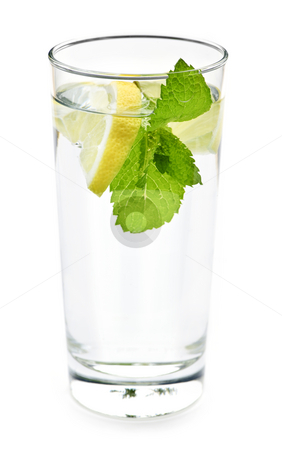 Glass of water with lemon and mint stock photo, Full glass of water with lemon and mint isolated on white background by Elena Elisseeva