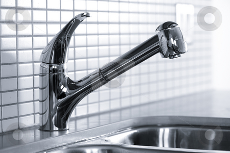 Kitchen faucet stock photo, Stainless steel kitchen faucet and sink with tile backsplash by Elena Elisseeva