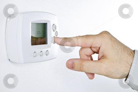 Hand setting digital thermostat stock photo, Closeup of hand pressing button on digital thermostat by Elena Elisseeva