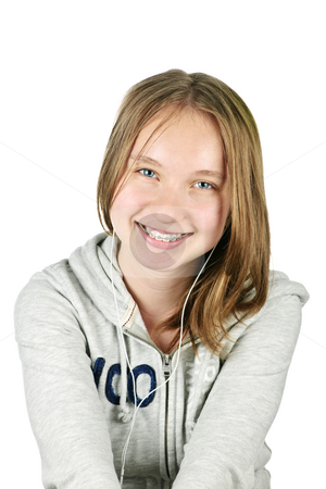 Teenage girl with earphones stock photo, Isolated portrait of beautiful teenage girl listening to earphones by Elena Elisseeva