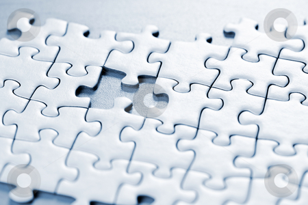 Missing puzzle piece stock photo, Jigsaw puzzle assembled with a piece missing by Elena Elisseeva