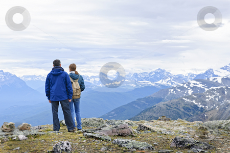 Hikers in mountains stock photo, Hikers enjoying scenic Canadian Rocky Mountains view in Jasper National Park by Elena Elisseeva