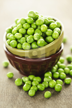 Bowl of peas stock photo, Bowl full of fresh green organic green peas by Elena Elisseeva