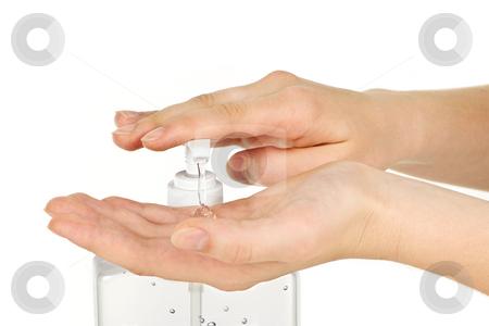 Hands with sanitizer gel stock photo, Female hands using hand sanitizer gel pump dispenser by Elena Elisseeva