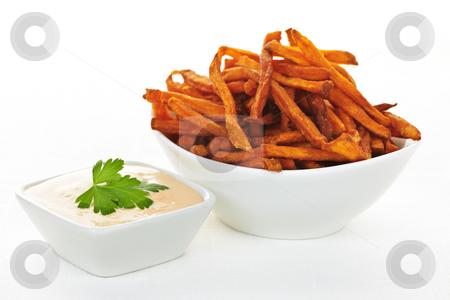 Sweet potato fries with sauce stock photo, Bowl of sweet potato or yam fries with dipping sauce by Elena Elisseeva