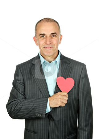 Man with paper heart on white background stock photo, Smiling man holding paper heart isolated on white background by Elena Elisseeva