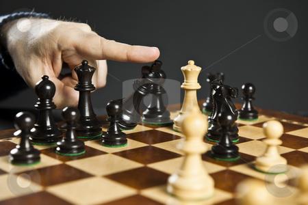 Checkmate in chess stock photo, Finger pushing over King chess piece in defeat by Elena Elisseeva