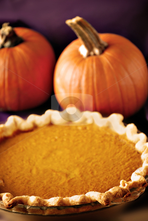 Pumpkin pie stock photo, Pumpkin pie and whole pumpkins on purple by HD Connelly