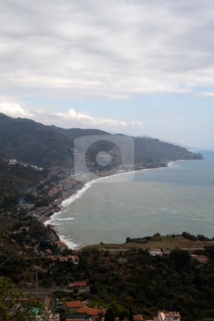 Coastline of Messina stock photo, Looking over the overcast hills of Messina, Italy by Kevin Tietz