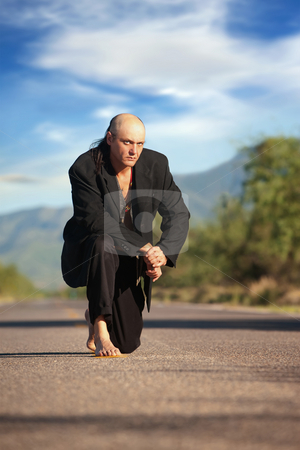 Indigenous man in the middle of a road stock photo, Strange indigenous man in the middle of a road by Scott Griessel