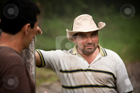 Handsome male ranch hands in Costa Rica stock photo, Handsome male ranch hands on dairy farm in Costa Rica by Scott Griessel