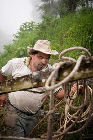 Costa Rican ranch hand stock photo, Costa Rican ranch hand with a rope by Scott Griessel