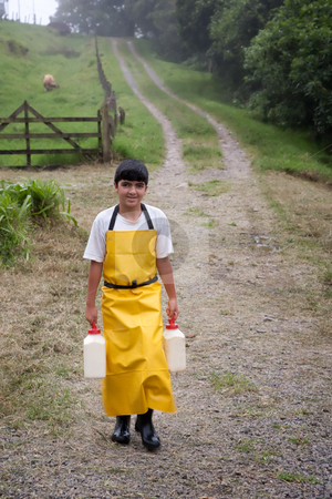 Young boy on Costa Rican dairy farm stock photo, Young boy working on Costa Rican dairy farm by Scott Griessel