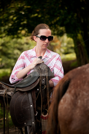 Tourist in Costa Rica with Horse stock photo, Female tourist in Costa Rica with white horse by Scott Griessel