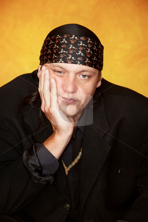 Bored or tired andsome mixed race man stock photo, Handsome mixed race man with tired expression on his face by Scott Griessel