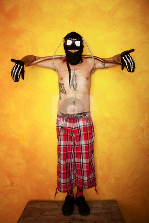 Strange Man stock photo, Strange man with arms stretched across a long stick by Scott Griessel