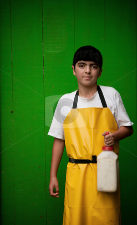 Young boy working on Costa Rican dairy farm stock photo, Young boy in apron working on Costa Rican dairy farm by Scott Griessel