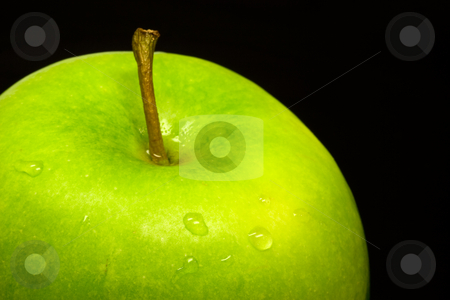 Apple stock photo, Fresh wet green apple on black background close up photo by GPimages