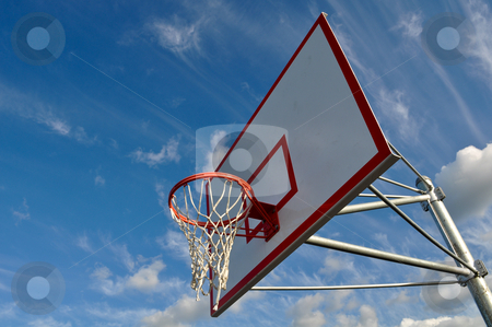 Basketball Hoop with Clouds and Blue Sky stock photo, Outdoor Basketball Hoop Close Up with Clouds and Blue Sky by Brandon Bourdages