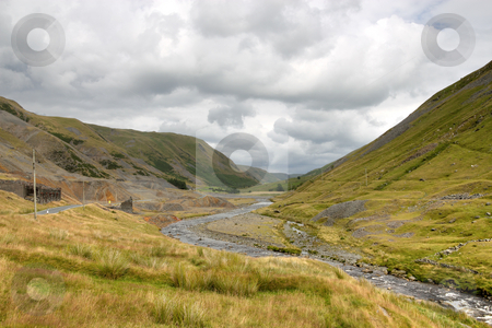 Cwmystwyth hills in Ceredigion Wales and ruins of the old lead mine. stock photo, Cwmystwyth hills in Ceredigion Wales and ruins of the old lead mine. by Stephen Rees