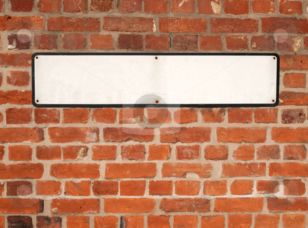 Old blank white British street sign on a red brick wall. stock photo, Old blank white British street sign on a red brick wall. by Stephen Rees