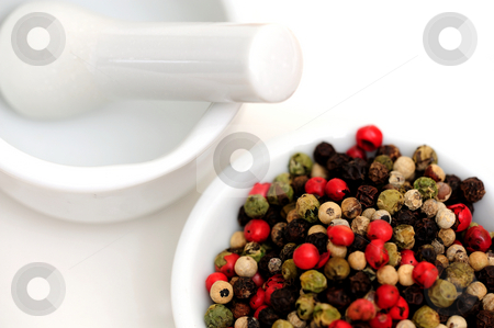 Peppercorns With Mortar And Pestle stock photo, Peppercorns in various colors of red, green and the familiar black peppercorn on white with a Mortar and Pestle by Lynn Bendickson