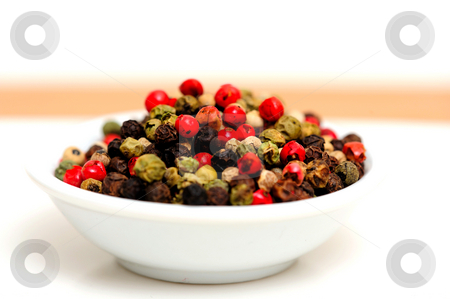 Gourmet Rainbow Peppercorns stock photo, Peppercorns in various colors of red, green and the familiar black peppercorn on white in a small bowl by Lynn Bendickson
