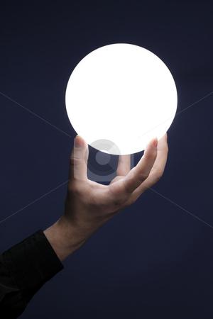 Globe of light stock photo, Man holding an illuminated sphere by Stocksnapper