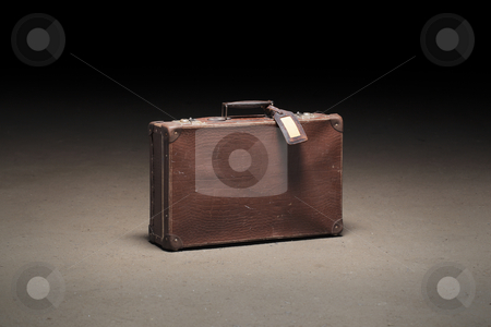 Old suitcase stock photo, Old brown suitcase abandoned on dirty concrete floor by Stocksnapper