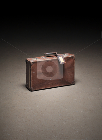 Old luggage stock photo, Old brown suitcase abandoned on dirty concrete floor by Stocksnapper