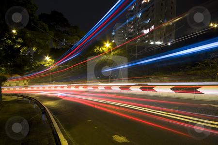 Traffic in city at night in hong kong stock photo, Traffic in city at night in hong kong by Keng po Leung