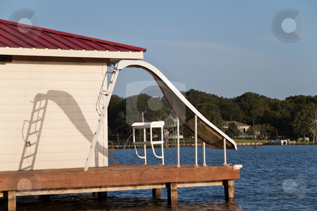 Waterslide stock photo, A waterslide on the end of a wooden dock by Kevin Tietz