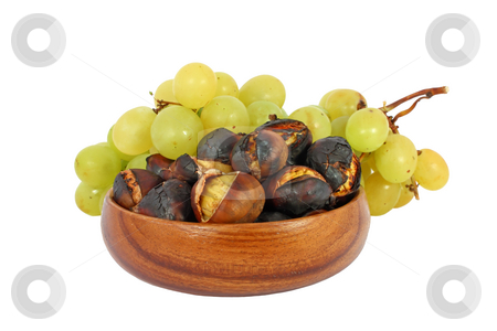 Chestnuts and grapes stock photo, Roasted chestnuts in a wooden bowl and grape isolated on white by Borislav Marinic