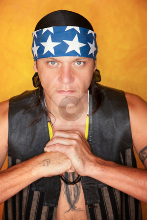 Handsome mixed race man with feather tattoo stock photo, Handsome mixed race man with feather tattoo making fist by Scott Griessel