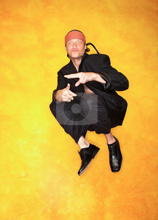 Handsome Mixed Race Man Jumping stock photo, Handsome mixed race man in black jacket jumping by Scott Griessel