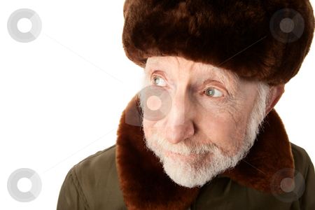 Russian Man in Fur Cap stock photo, Senior Russian Man in Fur Cap and jacket by Scott Griessel