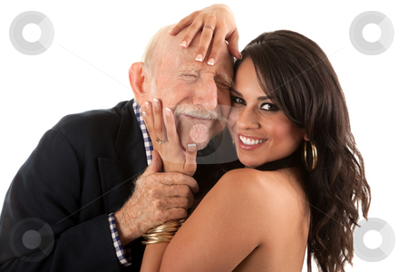Rich elderly man with gold-digger companion or wife stock photo, Rich elderly man with Hispanic gold-digger companion or wife by Scott Griessel