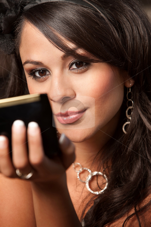 Beautiful Latina Woman with Compact stock photo, Beautiful Latina Woman Looking into Compact Mirror by Scott Griessel