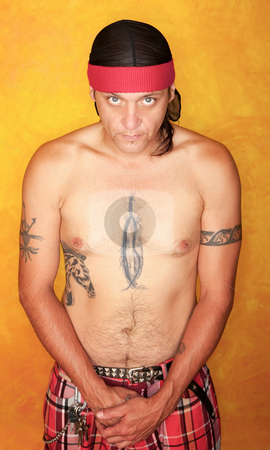 Native American Man stock photo, Handsome Native American man with tattoos and plaid pants by Scott Griessel
