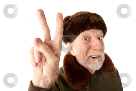 Russian Man in Fur Cap Making Peace Sign stock photo, Senior Russian Man in Fur Cap and Jacket Making Peace Sign by Scott Griessel
