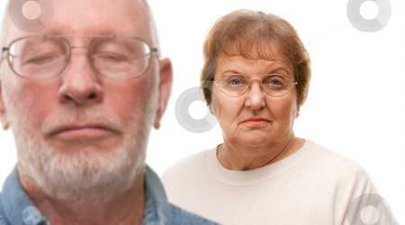Concerned Senior Couple Isolated on White stock photo, Concerned Senior Couple with Selective Focus the Woman in the Back. by Andy Dean