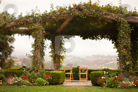 Vine Covered Patio and Chairs with Country View stock photo, Beautiful Vine Covered Patio and Chairs with Country View. by Andy Dean