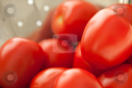Fresh, Vibrant Roma Tomatoes stock photo, Macro of Fresh, Vibrant Roma Tomatoes in Metal Colander Abstract. by Andy Dean